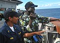 US Navy 100226-N-8463W-007 Ensign Emily Pena, an engineering officer aboard the guided-missile frigate USS Nicholas (FFG 47), instructs an Africa Partnership Station East student how to communicate ship coordinates with the bri.jpg