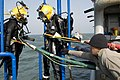 US Navy 100409-N-9123L-002 Dive tenders recover divers aboard the Military Sealift Command rescue and salvage ship USNS Salvor (T-ARS 52).jpg