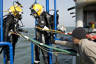 ROKS Cheonan sinking - A South Korean and U.S. diver during the recovery phase