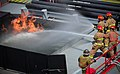 US Navy 100427-N-1522S-004 Sailors fight a fire during Damage Control Olympics during Fleet Week Port Everglades.jpg