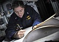 US Navy 100904-N-3620B-018 Lt. j.g. Brittany Lynn plots a course to an anchorage point from the pilothouse of USS Denver (LPD 9).jpg