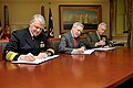 US Navy 110314-N-ZB612-014 Adm. Gary Roughead, left, along with the Honorable Ray Mabus and Gen. James F. Amos sign a Memorandum of Understanding o.jpg
