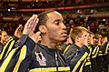 US Navy 110315-N-CM124-017 Russell Bonds, from Chicago, recites the oath of enlistment with 85 Chicago-area recruits at a swearing-in ceremony at.jpg