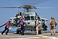 US Navy 110325-N-7293M-126 Sailors run to refuel an MH-60S Sea Hawk helicopter.jpg