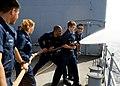 US Navy 110510-N-BZ392-108 Damage Controlman 2nd Class Bill Zhang, right, instructs Fire Controlman 3rd Class Allen Lemon, second from right.jpg