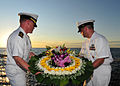 US Navy 110721-N-XR557-064 Cmdr. Stephen Erb, left, and Command Master Chief Chris Detje prepare to place a wreath in the ocean, commemorating the.jpg