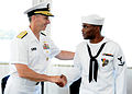 US Navy 110810-N-FC670-021 Vice Chief of Naval Operations (VCNO) Adm. Jonathan Greenert congratulates Master-at-Arms 3rd Class Quentin Benjamin aft.jpg