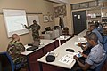 US Navy 110817-N-XK513-046 Chief Electrician's Mate Antonio Parrish, an instructor from Maritime Civil Affairs Security and Training, teaches an el.jpg