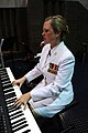 US Navy 110923-N-RH386-161 Musician 1st Class Caroline Koziol performs on keyboard at the start of the reception for the Chief of Naval Operations.jpg