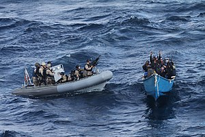 US Navy 111219-N-ZZ999-076 A visit, board, search and seizure team from the guided-missile destroyer USS Pinckney (DDG 91) approaches a suspected p.jpg