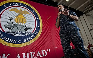 US Navy 111221-N-OY799-489 Capt. Ronald Reis, commanding officer of the the Nimitz-class aircraft carrier USS John C. Stennis (CVN 74), addresses t.jpg