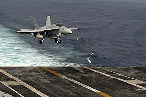 US Navy 120111-N-ZZ999-264 An F-A-18C Hornet, assigned to Strike Fighter Squadron (VFA) 25, approaches the flight deck aboard the Nimitz-class airc.jpg