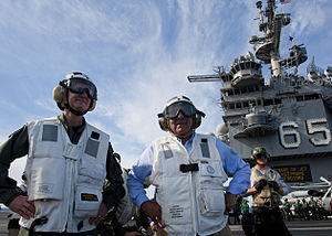 US Navy 120121-N-FI736-197 Secretary of Defense Leon E. Panetta, right, and Rear Adm. Walter E. Carter, commander of Carrier Strike Group (CSG) 12.jpg