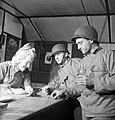 US soldiers purchasing bottles of mineral water at a NAAFI canteen in England during 1943. D17225.jpg