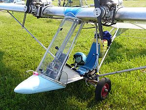 "Ultraflight Lazair - A Lazair Series III with its bottom-mounted control stick. This one has been modified with a streamlined pod and windshield. The engines are the Rotax 185 9.5 hp two-stroke powerplants driving ""biplane"" propellers."
