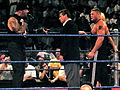 Undertaker, Vince McMahon, Brock Lesnar, & Sable in a WWE ring.JPG