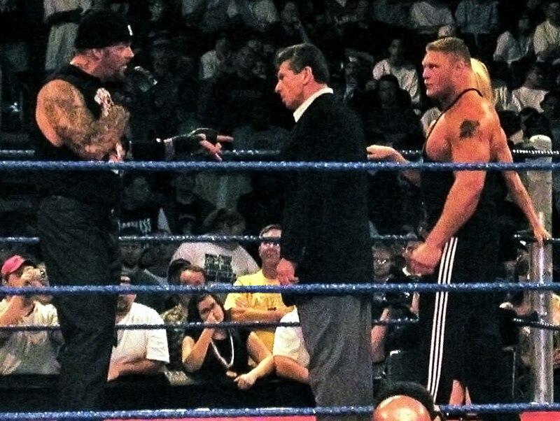 Undertaker, Vince McMahon, Brock Lesnar, %26 Sable in a WWE ring.JPG
