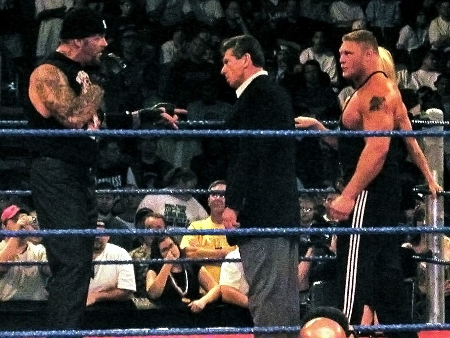 Undertaker, Vince McMahon, Brock Lesnar, %26 Sable in a WWE ring