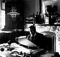 Victor Horta seated at own house (veranda).jpg