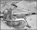 Vietnam....Private First Class Joseph Big Medicine Jr., a Cheyenne Indian, writes a letter to his family in the... - NARA - 532485.tif