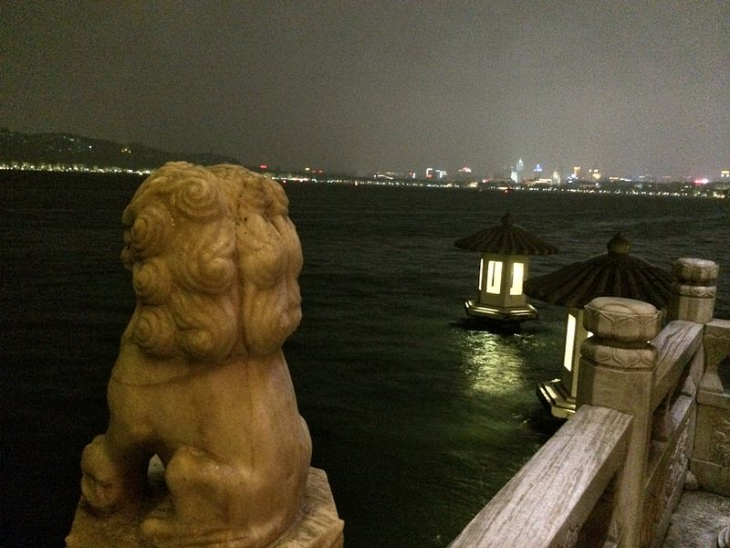 View of the night time Hangzhou skyline from the West Lake.JPG