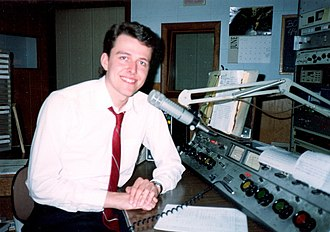 WTTF - Former WTTF-AM-FM afternoon announcer Ken Hawk in 1994, taken in the main on-air studio at former 185 South Washington Street studio location. The DW-76 is seen just below microphone boom (gray panel with two switches).