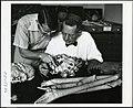 Waldo L. Schmitt and Thomas E. Bowman examining a giant crab of Japan.jpg