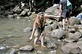 Walking on rocks in shallow water with arms spread.jpg