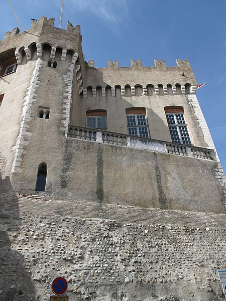Exterior wall of the Cagnes castle (Alpes-Maritimes, France). Walls and battlements are in medieval style, but large windows are in classic style.