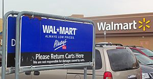 History of Walmart - New and old Walmart logos outside store in Newburgh, NY, 2012