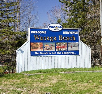 Wasaga Beach - Wasaga Beach town sign on Highway 26 in the west end of town. The sign has since been relocated to the highway's new bypass.