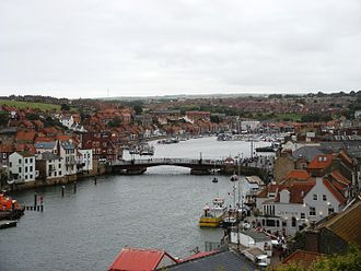 Whitby - Whitby Bridge, spanning the River Esk, opens to allow shipping access to the upper harbour.