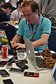 Wikimania 2012 - 12 - Multichill working at the mobile table.JPG