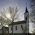 Wit gepleisterde noordgevel van kerk met geveltoren - Holysloot - 20409504 - RCE.jpg