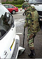With stepped up security, a 48th Security Force's member inspects the undercarriage of a vehicle before granting it permission to enter RAF Lakenheath, UK 010914-F-OK231-006.jpg