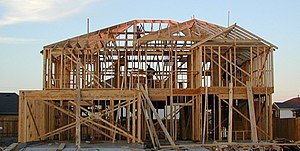 A Wooden Frame House Under Construction In This Example Of Platform Framing The Location Upper Floor Is Readily Discerned By Wide Joists