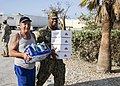 Yeoman 2nd Class Eric Coleman helps a Key West resident. (37054973976).jpg
