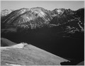 """In Rocky Mountain National Park,"" Colorado, panorama of barren mountains and shadowed valley., 1933 - 1942 - NARA - 519964.tif"