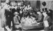 """Orient Saloon at Bisbee, Arizona... Faro game in full blast. Recognized, Left to right-Tony Downs (standing with derby) - NARA - 530986.tif"