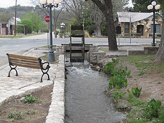"Menard, Texas - ""The Historic Ditch Walk"" began in 1876, when the Vaughn Agricultural and Mechanical Canal Company sought to provide irrigation by gravity flow from the nearby San Saba River to 2000 acres of land and to provide power for gristmills."