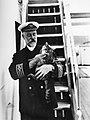 (Captain A. J. Hailey in uniform with a cat on the first C.P. R.M.S. Empress of Canada) (11422932766).jpg
