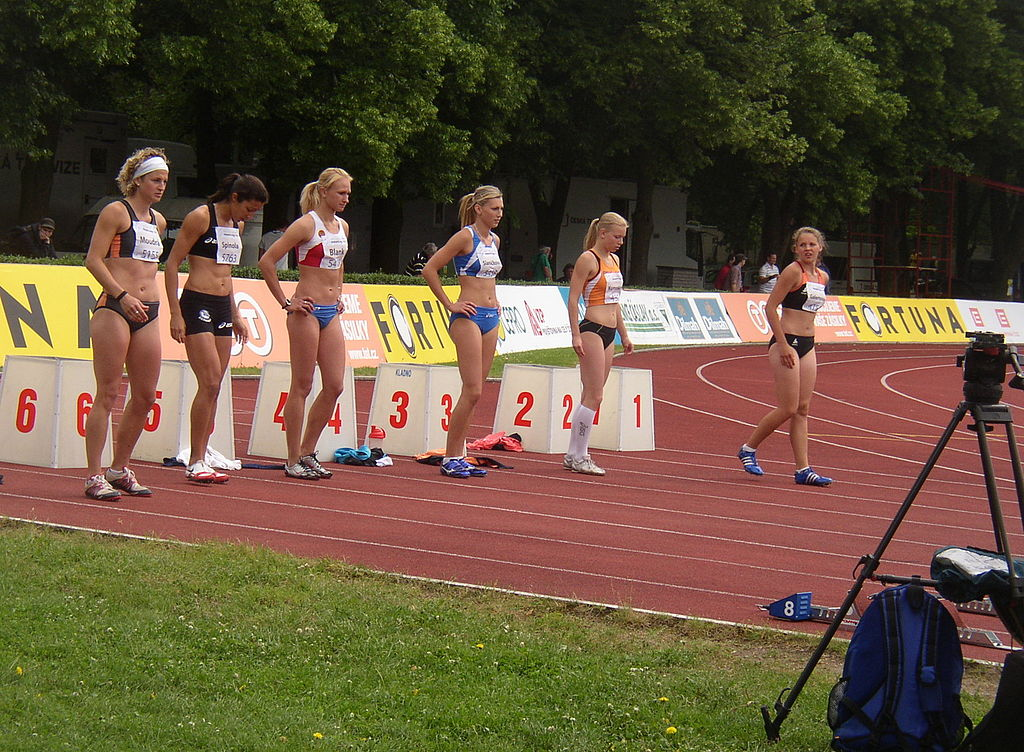 Athletes awaiting start of third heat of women's 100m hurdles at 4th edition of the TNT - Fortuna Meeting (IAAF World Combined Events Challenge Meeting, Sletiště Stadium, Kladno, Czech Republic, 15 June 2010, 11:41). 1 - - 2 - # Alena Galertová (CZE) 15.12 s 3 - Aneta Komrsková (CZE) 15.17 s 4 - Lucie Slaničková (SVK) 14.43 s 5 - Anna Blank (RUS) 14.61 s 6 - Vanessa Spinola (BRA) 14.49 s 7 - Jitka Moudrá (CZE) 15.26 s 8 - - wind: -0.5 m/s