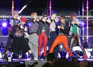 NCT (band) - NCT 127 performing in Busan (From left: Winwin, Yuta, Taeil, Taeyong, Jaehyun, Haechan, Mark)