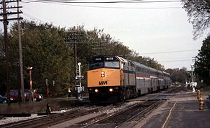International (Amtrak train) - A Via Rail EMD F40PH leads the International with Amtrak Hi-Level and Superliner coaches into East Lansing in 1996