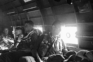 2/4th Field Regiment (Australia) - 2/4th gunner's aboard a C-47 prior to a combat jump over Nadzab, September 1943