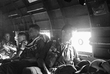 2/4th Field Regiment gunners shortly before they participated in the parachute landing at Nadzab 2-4-FA regt in C-47.jpg