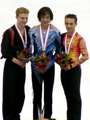 Frédéric Dambier - The men's podium at the 2004 NHK Trophy. From left: Timothy Goebel (2nd), Johnny Weir (1st), Frédéric Dambier (3rd)