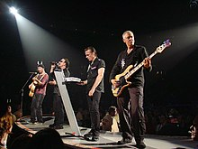 U2 performing on 17 May 2005. From left to right: The Edge, Bono, Larry Mullen Jr., and Adam Clayton.