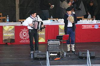 Trikiti - Performance featuring a trikiti with tambourine accompaniment
