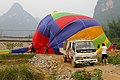 20090502 Collapsing a balloon Yangshuo 5928.jpg